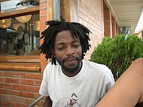 Man with dreadlocks.