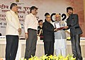 Pranab Mukherjee presenting the Rajat Kamal Award for Best Actor Paan Singh Tomar (Hindi), to Shri Irrfan Khan, at the 60th National Film Awards function.jpg