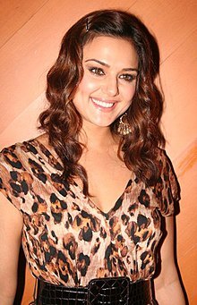 Preity Zinta is smiling away from the camera.