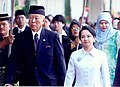 President Gloria Macapagal-Arroyo walks with His Majesty, the Yang Di-Pertuan Agong of Malaysia, and his wife, Raja Permaisuri Agong.jpg