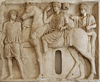 October Horse - Funerary relief depicting the deceased riding a horse and pointing to his head where the Genius resides (2nd century AD)