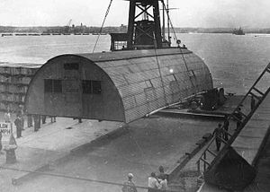 Quonset hut - A Quonset hut being put in place at the 598th Engineer Base Depot in Japan, post-World War II