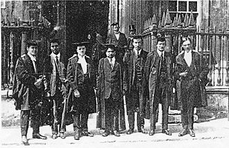 Srinivasa Ramanujan - Ramanujan (centre) and his colleague G. H. Hardy (extreme right), with other scientists, outside the Senate House, Cambridge, c.1914–19
