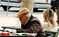 Reading the newspaper (435347999).jpg