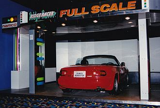 Ridge Racer (video game) - Ridge Racer Full Scale.  The car's controls are used to race.