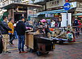 Roasted sweet potatoes and chestnuts hawkers (Hong Kong).jpg