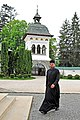 Romania-1492 - Bell Tower and Monk (7604824262).jpg