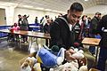 Sailor searches for a specific stuffed animal request for a child during the Toys for Tots. (31726638166).jpg