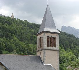 "Saint-Disdier, with the parish church in the foreground, and the ""Mother Church"" on the hill"