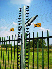 multizone security electric fence used alongside a physical barrier