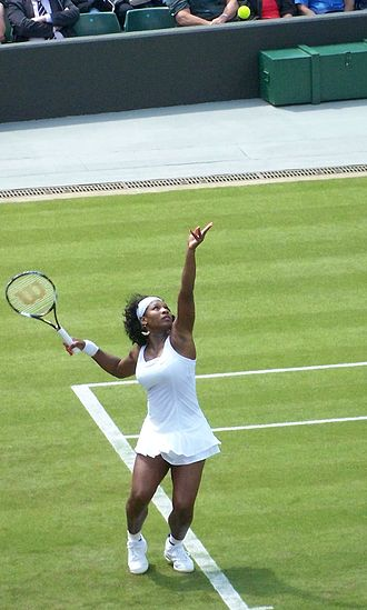Grass court - Serena Williams serving at the 2008 Wimbledon Championships.