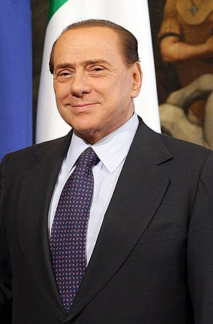 English: Silvio Berlusconi in a meeting with J...