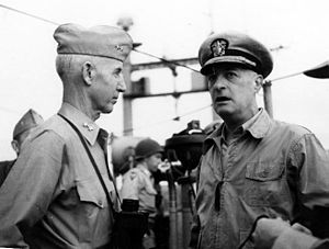 Oliver P. Smith - MajGen O.P. Smith (left) and VAdm James H. Doyle, USN,  confer on board USS Mount McKinley (AGC-7), immediately prior to the Inchon Invasion.