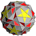 Snub dodecadodecahedron with grey triangle.png