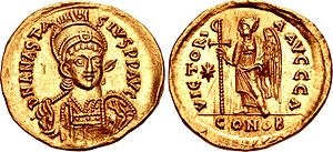 Staurogram - A solidus minted under Anastasius I Dicorus (struck in Constantinople between 507–518). On the obverse is Victory standing left, holding a staff surmounted by a staurogram.