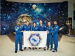 Soyuz MS-15 prime and backup crews at the Baikonur Cosmodrome Museum.jpg