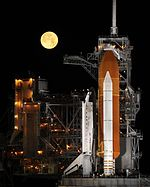 Space Shuttle Discovery under a full moon, 03-11-09.jpg