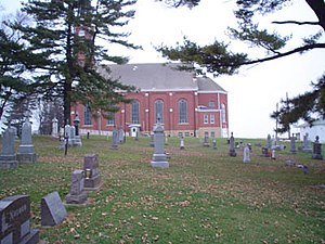 Roman Catholic Archdiocese of Dubuque - Side view of Saints Peter and Paul Church, from the cemetery.