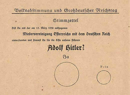 "Voting ballot from 10 April 1938. The ballot text reads ""Do you agree with the reunification of Austria with the German Reich that was enacted on 13 March 1938, and do you vote for the party of our leader Adolf Hitler?"" The large circle is labelled ""Yes"", the smaller ""No"". Stimmzettel-Anschluss.jpg"