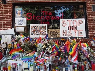 Stonewall Inn - A memorial for the 2016 Orlando nightclub shooting covers the exterior on Pride weekend 2016