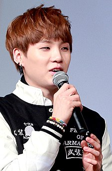 Suga at a fanmeeting in Yeouido in March 2014 02.jpg