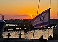Sunset with Israeli Flag on Boat at Jaffa Harbour. - panoramio.jpg