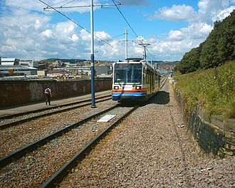 Sheffield Supertram - Siemens-Duewag Supertram 122, operating the Purple Route to Herdings Park, on the permanent way leaving Sheffield station for Sheffield College (Granville Road) in July 2004