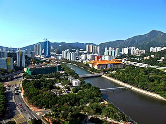 Tai Wai - View of Tai Wai and the Shing Mun River, looking southwest. Che Kung Temple Station is visible on the left and the Hong Kong Heritage Museum on the right.