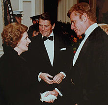 220px-Thatcher_with_Reagan_and_Charlton_