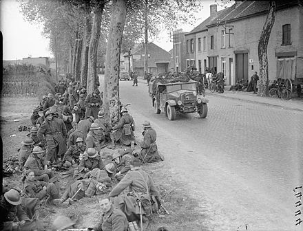 Belgian soldiers resting at the roadside The British Army in France and Belgium 1940 F4444.jpg