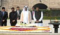 The Crown Prince of Abu Dhabi, His Highness Sheikh Mohammed Bin Zayed Al Nahyan paying homage at the Samadhi of Mahatma Gandhi, at Rajghat, in Delhi.jpg