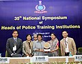 The Lt. Governor of Puducherry, Dr. Kiran Bedi being presented a memento at the inauguration of the 35th National Symposium of Heads of Police Training Institutions, in New Delhi on March 23, 2017.jpg