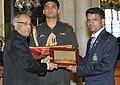 The President, Shri Pranab Mukherjee felicitates Shri Vijay Kumar, the London Olympic Silver Medal winner in Shooting, at a function, in New Delhi on August 18, 2012.jpg