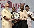 The Prime Minister, Shri Narendra Modi presenting the Eldest Tamil Scholar Award to Shri Erode Tamilanban, on the occasion of the Platinum Jubilee of the Daily Thanthi, in Chennai.jpg