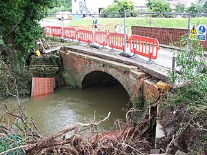 River Isbourne -  Damage to the roadbridge across the Isbourne near Hinton-on-the-Green after 2007 floods