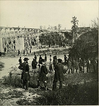1st Regiment Michigan Volunteer Engineers and Mechanics - Engineers and infantry busy at the Elk River Bridge, Tennessee, providing rail passage for the Union troops