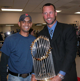 Tim Wakefield - Wakefield (right) holding the 2004 World Series Trophy