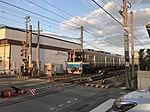 Train for Fukuoka Airport Station near Itoshima-Kokomae Station.jpg