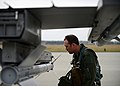U.S. Air Force 1st Lt. Matthew Alexander, a pilot with the 555th Fighter Squadron, performs a preflight inspection on an F-16 Fighting Falcon aircraft at Lask Air Base, Poland, before a training mission 140318-F-BH566-067.jpg
