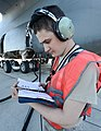 U.S. Air Force Senior Airman Justin Williford, a C-5 Galaxy aircraft crew chief assigned to the 436th Aircraft Maintenance Squadron, reviews a technical manual during a refueling operation at Dover Air Force 131002-F-VV898-003.jpg