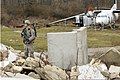 U.S. Army Spc. Jeffrey Ausborn, with a site security team, Charlie Company, Task Force Raptor, provides security while his team searches a downed aircraft for sensitive items during a training scenario at Camp 120119-A-FG822-008.jpg