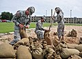 U.S. Army students assigned to Naval Construction Training Center Gulfport, Miss., fill sandbags at the center Aug. 27, 2012, in preparation for Tropical Storm Isaac 120827-N-AW868-028.jpg