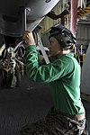 U.S. Marine Corps Cpl. Kristen M. Starkus, assigned to Marine Fighter Attack Squadron (VMFA) 323, places tape on an F-A-18C Hornet aircraft aboard the aircraft carrier USS Nimitz (CVN 68) in the Gulf of Oman 130619-N-PM023-002.jpg