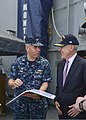 U.S. Navy Capt. Thomas Kiss, left, the commanding officer of the guided missile cruiser USS Monterey (CG 61), reviews a tour schedule with Secretary of the Navy Ray Mabus during Mabus' visit to the ship 130516-N-QL471-038.jpg