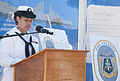 U.S. Navy Culinary Specialist 2nd Class Andrea Coleman, assigned to the littoral combat ship Pre-Commissioning Unit Jackson (LCS 6), recites the meaning of the ship's crest during a crest unveiling ceremony 130827-N-YQ852-055.jpg
