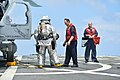 U.S. Navy Hull Maintenance Technician 1st Class Edward Buchanan, center, trains Hull Maintenance Technician Fireman Garrett Trotta and Damage Controlman 2nd Class Tavoris West during a flight deck crash 130807-N-YZ751-090.jpg