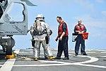 U.S. Navy Hull Maintenance Technician 1st Class Edward Buchanan, center, trains Hull Maintenance Technician Fireman Garrett Trotta and Damage Controlman 2nd Class Tavoris West during a flight deck crash 130807-N-YZ751-090.jpg