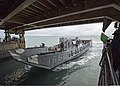 U.S. Navy Landing Craft Utility 1660 enters the well deck of the amphibious dock landing ship USS Gunston Hall (LSD 44) in the Atlantic Ocean Dec. 7, 2013 131207-N-XJ695-313.jpg