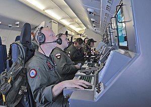 Search for Malaysia Airlines Flight 370 - Crew members on board a P-8A Poseidon manning terminals while searching for surface debris and locator beacons from Flight 370 in the southern Indian Ocean.