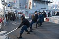 U.S. Sailors aboard the guided missile destroyer USS Stout (DDG 55) heave mooring lines as the ship pulls into port in Haifa, Israel, Jan. 19, 2014, for a scheduled port visit 140119-N-UD469-520.jpg